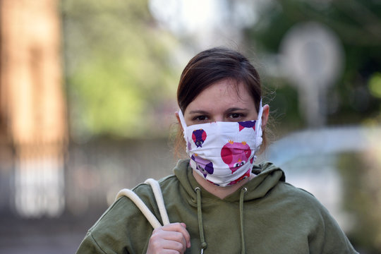 Young woman wearing a diy facemask for protection against coronavirus