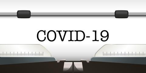 Le mot COVID-19 écrit en majuscule sur une page blanche à la machine à écrire.