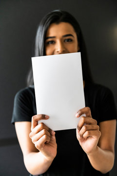 Woman of color holding a blank A5