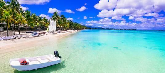 Wall Mural - Beach activities in tropical paradise Mauritius island. Trou aux Biches beach