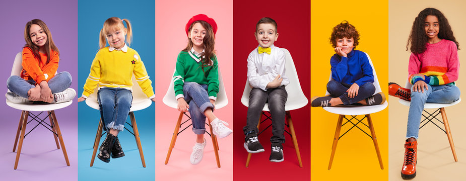 Cheerful kids in stylish clothes sitting on chairs