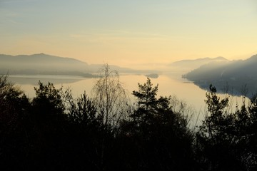 Beautiful sunrise view of the WortherSee lake from the Ferienhotel WortherSee located on the northern shores of the lake. It is the largest lake in Carinthia, Austria. Wall mural