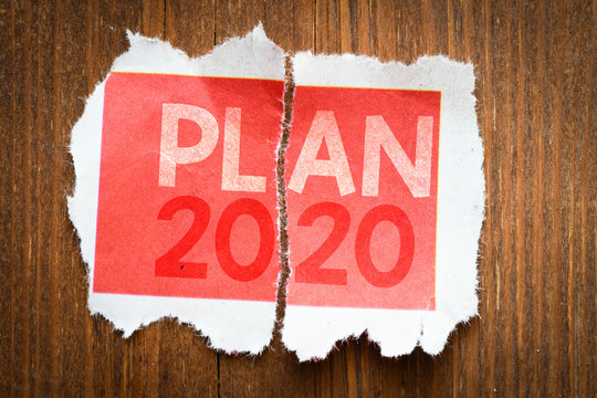 PLAN 2020 word on a torn page. Business concept.