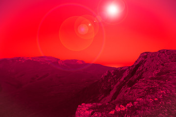 Photo sur Aluminium Rouge Mesmerizing picturesque mountain landscape with a full moon at night. Concept of pristine nature and the mystic moon. Advertising space