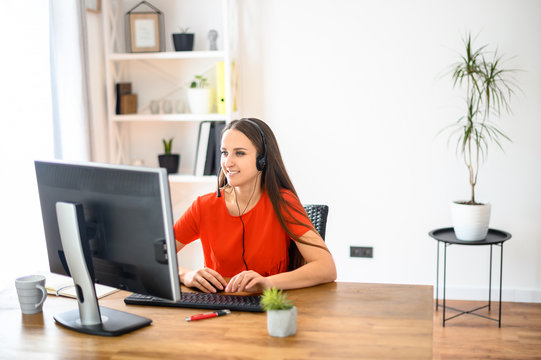 Woman using headset and pc for work