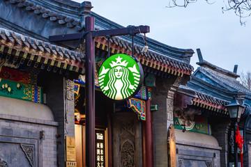 Beijing, China - February 9, 2019: Logo of Starbucks in Nanluoguxiang renovated hutong in Beijing city