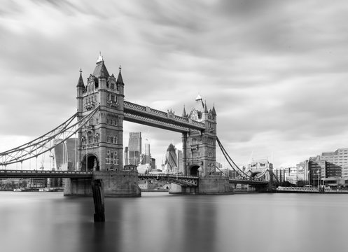Tower bridge in black and white during the day. Long exposure