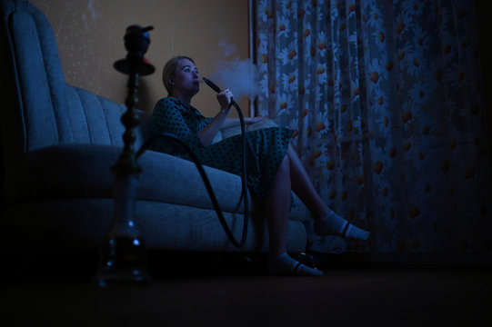 Evgenia Pivovarova smokes a hookah during self-isolation at home in the southern city of Rostov-on-Don