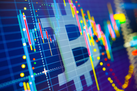 Data analyzing in exchange stock market: the candle chars on display. Classic BTC/Bitcoin volatility against the US dollar. Statistics changes of cryptocurrency price.