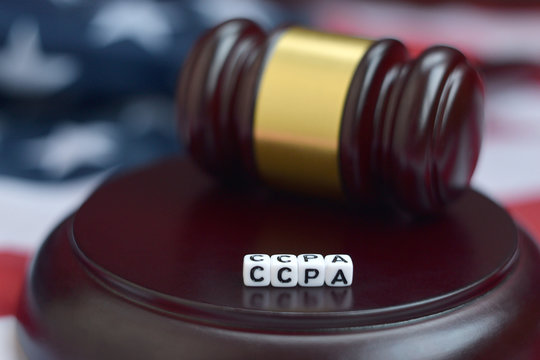 Justice mallet and CCPA acronym with US flag on background. California consumer protection act