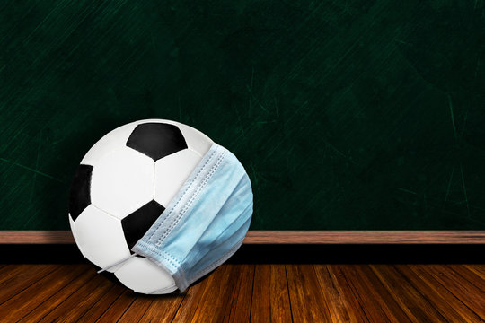 Soccer Ball Wearing Mask With Chalkboard Background and Copy Space