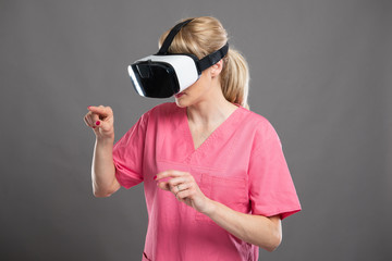 Portrait of attractive female nurse working wearing virtual reality goggles