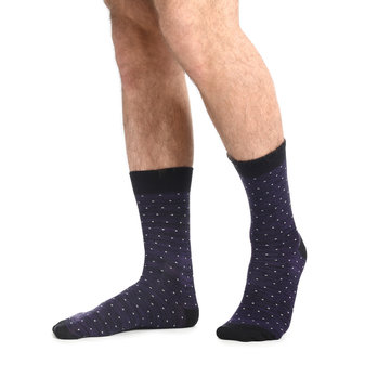 Male legs in socks on white background