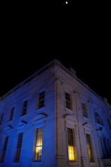 The North Portico of the White House is illuminated in blue for Autism Awareness Day, in Washington