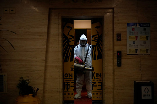 A volunteer from the Blue Sky Rescue team  wearing a protective suit is seen at the Qintai Grand Theatre in Wuhan