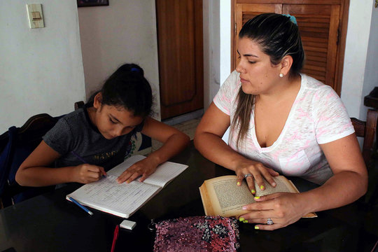 A girl does his homework after the closing of schools during the nationwide quarantine due to coronavirus disease (COVID-19) outbreak in San Cristobal