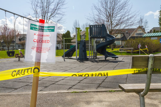 COVID closed Playground sign and park bench