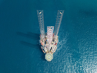Wall Mural - Aerial view offshore jack up rig being towed to the location