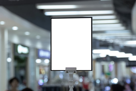 mockup white poster stand in front of blur background for show or present promotion product concept
