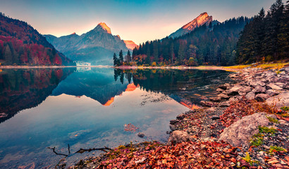 Two mountain peaks are reflected in the calm surface of the lake water. Colorful autumn view of Obersee lake, Nafels village location. Nice morning scene of Swiss Alps, Switzerland, Europe. Fotomurales