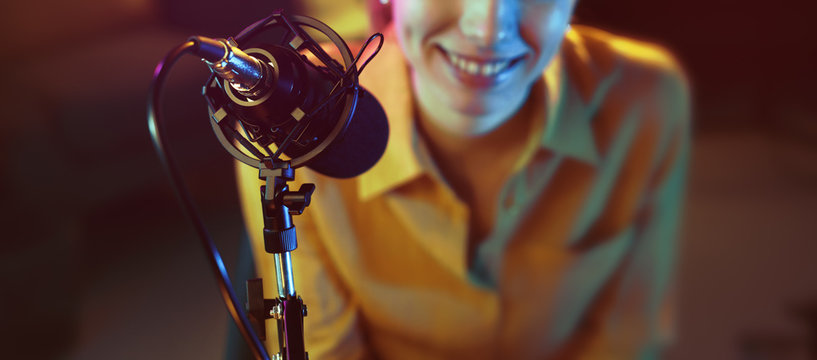 Young radio host in the radio broadcasting station