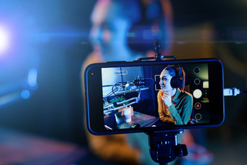 Young woman streaming a live video