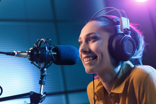 Young woman working at the radio station