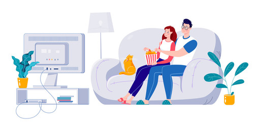Married couple watching a movie on a big screen sitting on a sofa at home. Self-isolation at home.