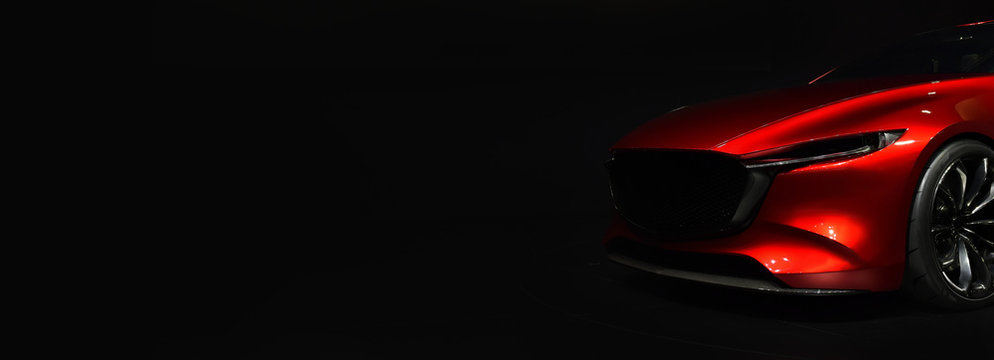 Red modern car headlights on black background,copy space