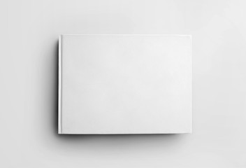 Foto auf Acrylglas Weiß Mockup blank white closed book isolated on background, front view. Hardcover landscape orientation object template for design presentation.