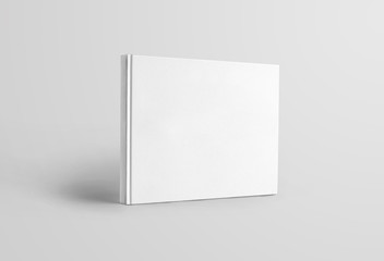 Mockup blank landscape orientation of a book standing and isolated on a white background, front view.