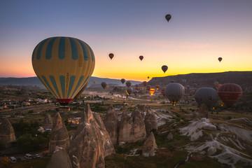 Poster de jardin Paris Hot Air balloons flying over amazing rock forms in Cappadocia