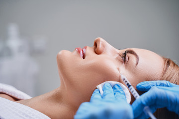 Calm pretty female during mesotherapy stock photo