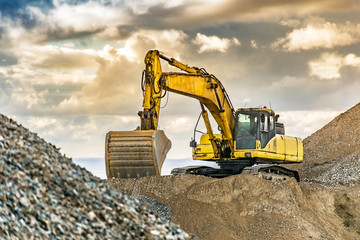 Excavator on the road construction works. Machinery needed for construction