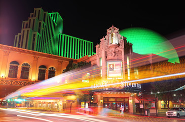 RENO, USA - AUGUST 12: Silver Legacy resort and casino at night with moving lights from passing traffic on August 12, 2014 in Reno, USA. Reno is the most populous Nevada city outside of the Las Vegas