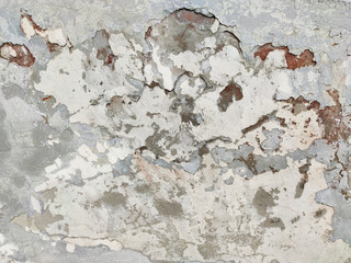 The old cracked wall is beige and gray.Grunge fashion background.