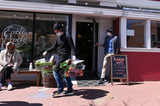 An Each Peach Market employee prepares to package produce for delivery in the Mount Pleasant neighborhood of Washington