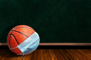 Basketball Wearing Mask With Chalkboard Background and Copy Space