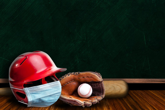 Baseball Helmet Wearing Mask With Chalkboard Background and Copy Space