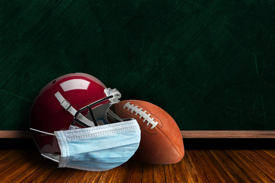 Football Helmet Wearing Mask With Chalkboard Background and Copy Space