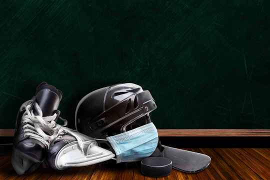 Ice Hockey Helmet Wearing Mask With Chalkboard Background and Copy Space