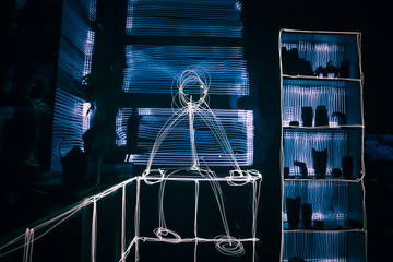 Light Painting  of a stickman sitting in the room with Long Exposure Photography. Wall mural