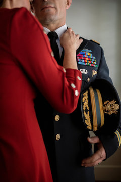 Affectionate wife and military officer husband in dress uniform