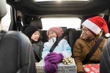 Children talking in back seat of car