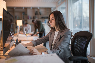 Mid adult woman working at desk in office