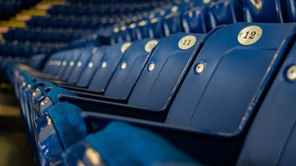 Empty rows of blue stadium seats