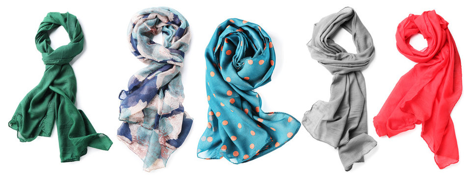 Different beautiful scarves on white background