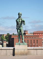 "TAMPERE. FINLAND. 20 JUIY 2012 : Sculpture ""Trader"" on Hameensilta bridge in Tampere. Finland"