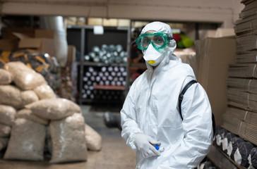 Fototapeta Disease spraying man in suit