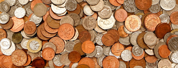 British currency, hundreds of copper and silver coloured coins piled randomly on top of each other, one pond coin, fifty pence, twenty pence, ten pence, five pence, two pence, one pence Wall mural